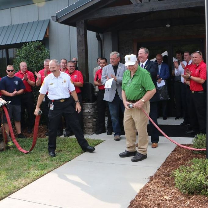 Ken Hair and Bobby Coffey uncouple the fire hose during the Station No. 3 Dedication Ceremony