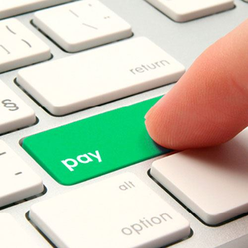 A keyboard with a green pay button where the enter button normally is