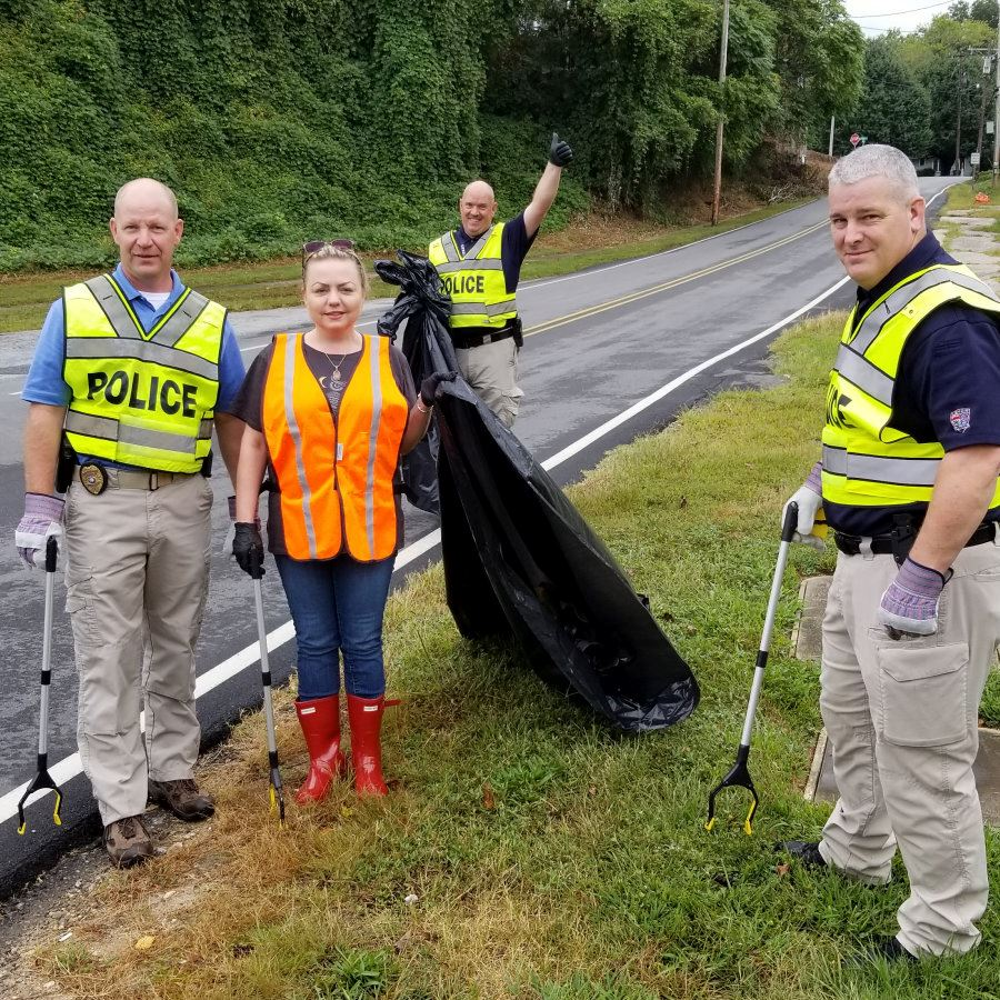 Staff with the Lenoir Police Department pick up litter on North Main Street in Lenoir
