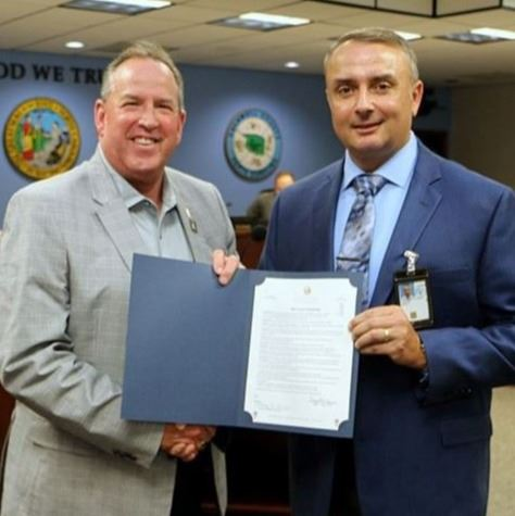 Mayor Joe Gibbons presents the 2020 Census resolution to Mark Lastoria on Sept. 3, 2019