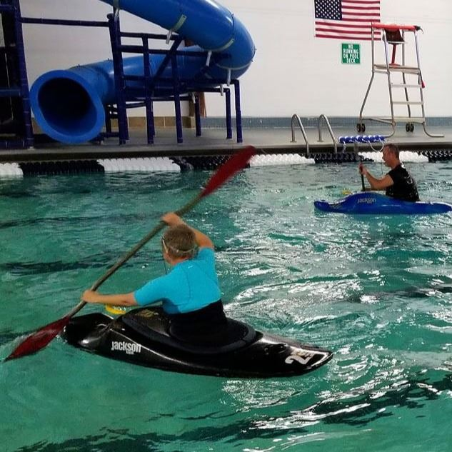 Kayakers paddle in the indoor pool at the Lenoir Aquatic and Fitness Center
