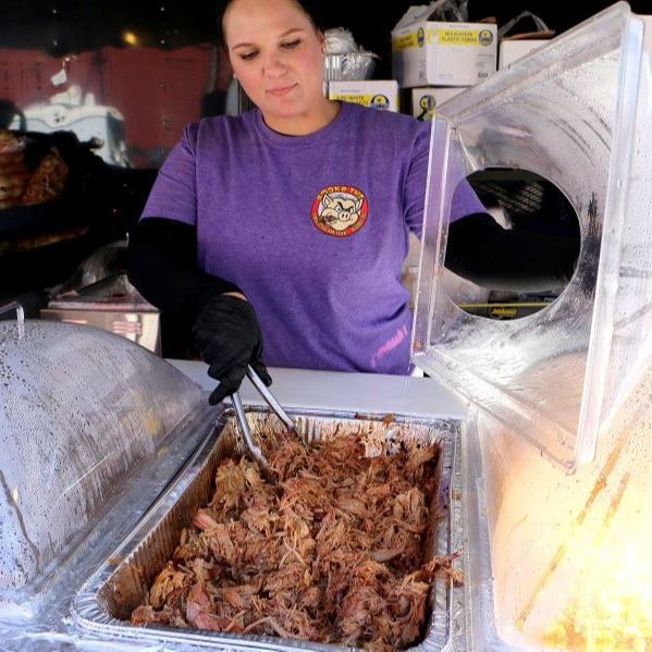 A vendor serves bbq during the 2018 Smoking In The Foothils Festival in Downtown Lenoir.