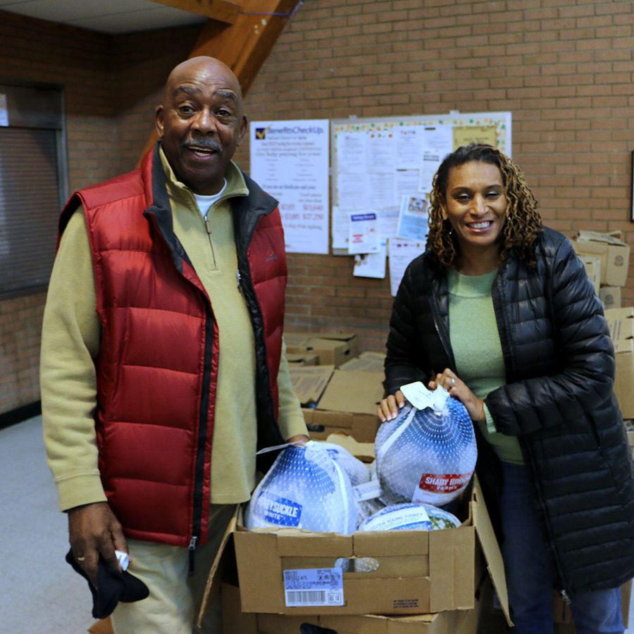 Councilmembers Ike Perkins and Crissy Thomas show off the turkeys bought for Turkey Tuesday.