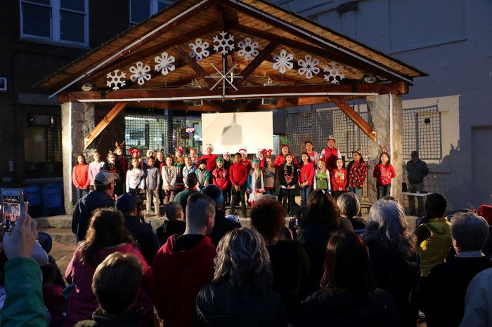 Students singing on the downtown stage during Light Up Lenoir in Downtown Lenoir, Nov. 16, 2018