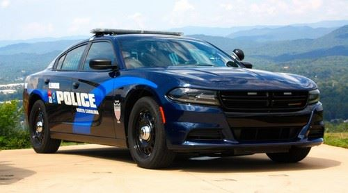 Black and blue police cruiser