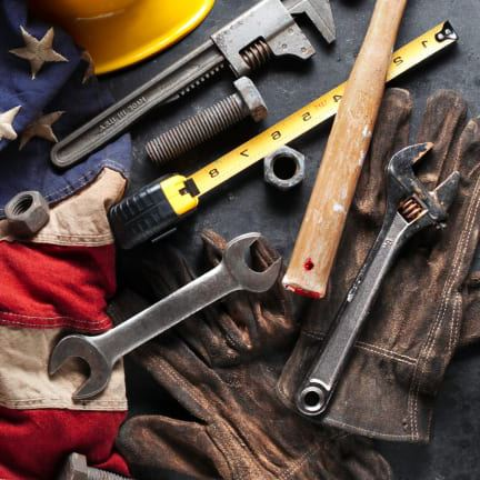 Photo showing tools laying on part of the American flag
