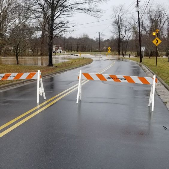 Barricades on Pennell Street at Zacks Fork Creek due to flooding