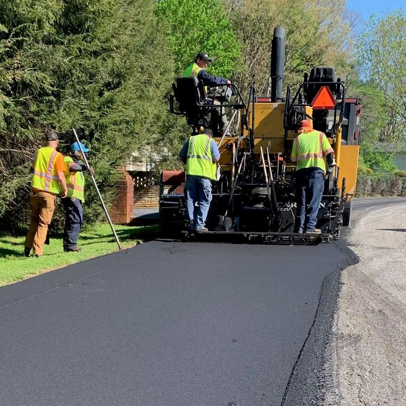 Workers pave Victoria Court in Lenoir, NC