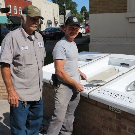 Mike Engstrom and Donavan Church work on the casings for the Charters of Freedom in Downtown Lenoir