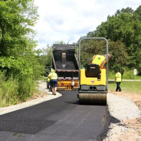 City workers pave the access trail at Wilson Athletic Park in Lenoir