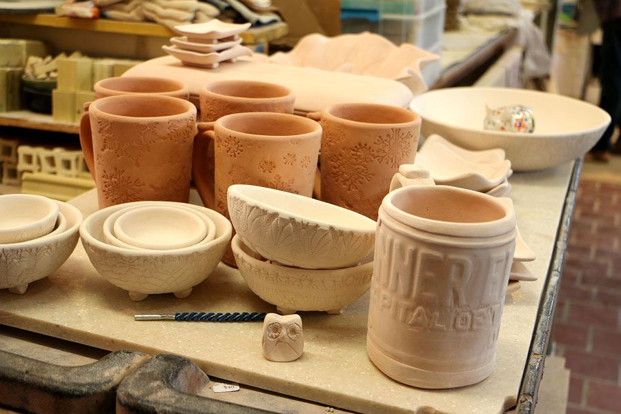 Pottery waiting to be glazed and fired in the pottery studio at the Lenoir High School in Lenoir