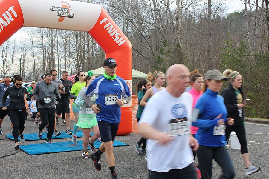 Runners start the Leprechaun Leap race, March 17, 2018, at the Lenoir Rotary Soccer Complex in Lenoi
