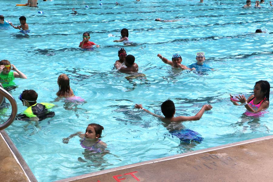 Kids swimming in the outdoor pool at the Lenoir Aquatic and Fitness Center