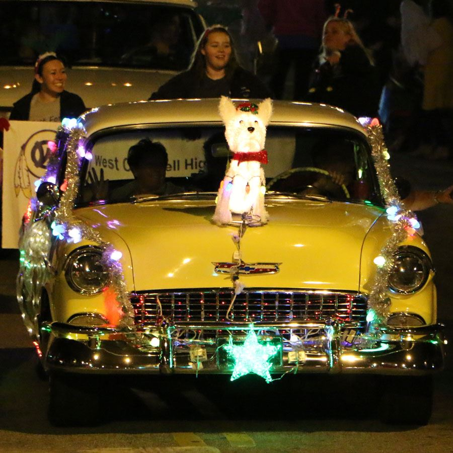 An old, yellow Chevy in the Downtown Lenoir Christmas Parade, Nov. 30, 2018
