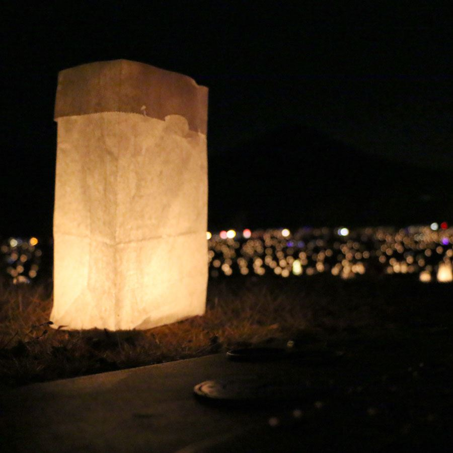 A single luminary illuminated at night at Blue Ridge Memorial Park, Dec. 152017