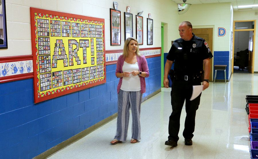 Jessica Anthony and Scott Kanupp walk in the a hallway at Davenport A+ Elementary School