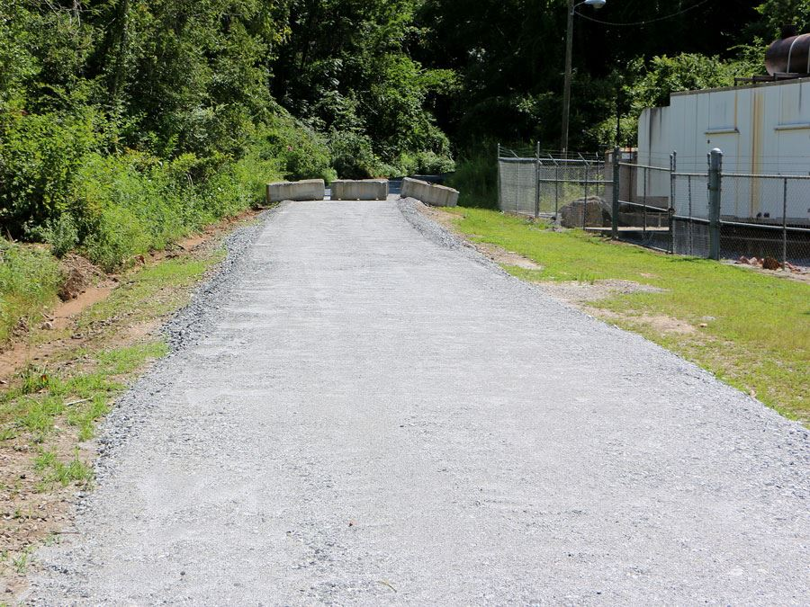 Stone base is been placed on the Rail Trail at North Main Street in Lenoir