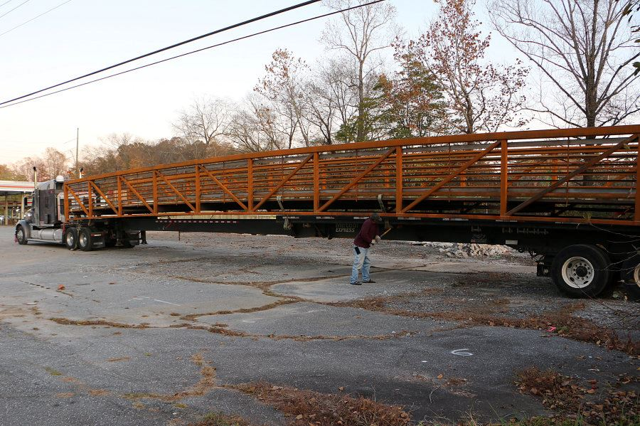 An 80-foot pedestrian bridge sits on a transfer truck at the Google greenway extension in Lenoir