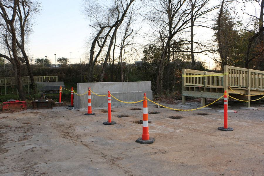 Two abutments on either side of Lower Creek will hold a new greenway pedestrian bridge.
