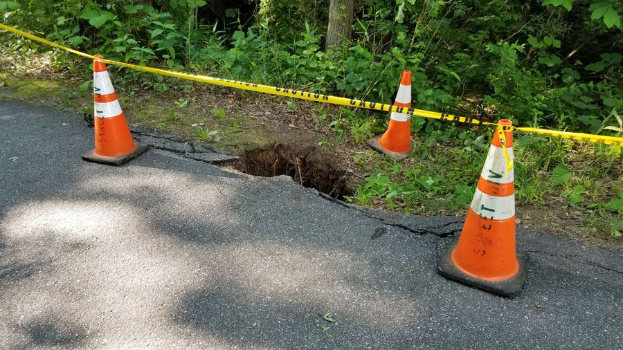 A close up of the sinkhole on the greenway