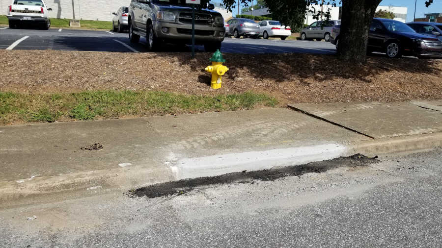 A section of repaired curb on Mulberry Street in front of the hospital