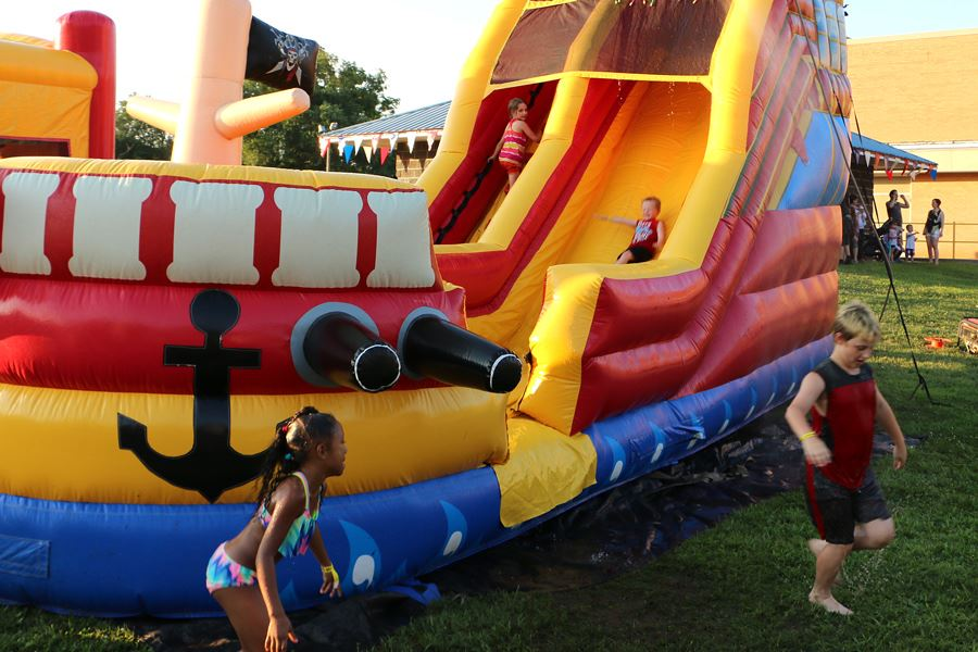 Kids slide down a water slide during the July 4, 2018, Independence Day Celebration