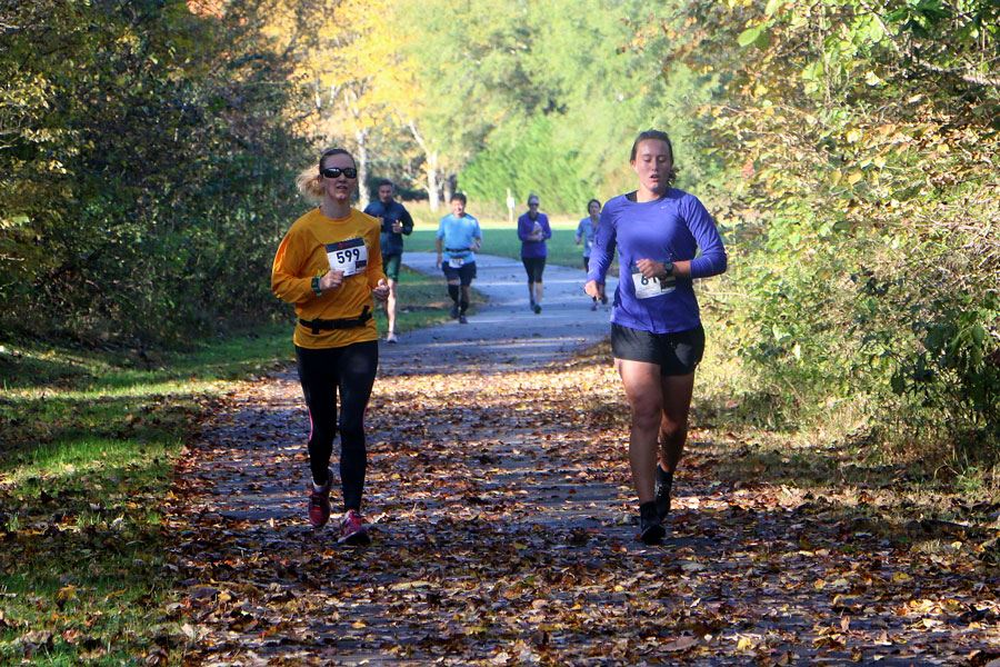 Two women run the Meleah Mikeal Half Marathon Nov 3, 2018, in Lenoir