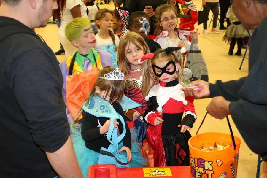 Kids getting candy at the 2018 Halloween Carnival in Lenoir